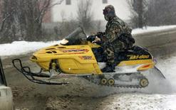 A member of the Serbian special police force patrols the village of Lucane on a Ski-Doo, in this file photo from February 2, 2001. REUTERS/Goran Tomasevic