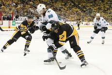 Pittsburgh Penguins center Matt Cullen (7) battles for the puck with San Jose Sharks defenseman Brent Burns (88) in the second period in game five of the 2016 Stanley Cup Final at Consol Energy Center. Mandatory Credit: Charles LeClaire-USA TODAY Sports