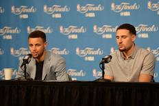 Golden State Warriors guard Stephen Curry (30) and guard Klay Thompson (11) speaks to the media during a press conference after game four of the NBA Finals against the Cleveland Cavaliers at Quicken Loans Arena. The Warriors won 108-97. Mandatory Credit: Ken Blaze-USA TODAY Sports