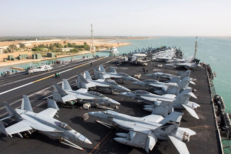 Second us aircraft carrier enters mediterranean us navy the us navy aircraft carrier uss harry s truman transits the suez canal egypt towards the mediterranean sea in a photo released by the us navy june 2 sciox Gallery