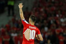 Football Soccer - Switzerland v France - EURO 2016 - Group A - Stade Pierre-Mauroy, Lille, France - 19/6/16 Switzerland's Granit Xhaka rips his shirt REUTERS/Gonzalo Fuentes Livepic