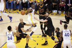 June 19, 2016; Oakland, CA, USA; Golden State Warriors forward Draymond Green (23) passes the ball to guard Shaun Livingston (34) against Cleveland Cavaliers forward Richard Jefferson (24), forward Kevin Love (0) and forward LeBron James (23) in the second half in game seven of the NBA Finals at Oracle Arena. Mandatory Credit: Kelley L Cox-USA TODAY Sports