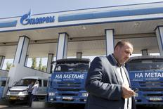A man walks past trucks at a Gazprom gas station in the southern city of Stavropol, Russia, September 29, 2015. REUTERS/Eduard Korniyenko