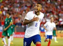 Jun 10, 2016; Foxborough, MA, USA; Chile midfielder Arturo Vidal (8) celebrates his penalty kick goal in extra time during the second half of Chile's 2-1 win over Bolivia in the group play stage of the 2016 Copa America Centenario at Gillette Stadium. Mandatory Credit: Winslow Townson-USA TODAY Sports