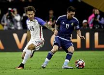 Jun 21, 2016; Houston, TX, USA; Argentina midfielder Lionel Messi (10) kicks the ball as United States defender Fabian Johnson (23) defends during the first half in the semifinals of the 2016 Copa America Centenario soccer tournament at NRG Stadium.   Kevin Jairaj-USA TODAY Sports