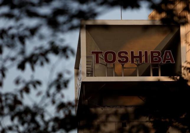 The logo of Toshiba Corp is seen behind trees at its headquarters in Tokyo, Japan, November 6, 2015. REUTERS/Yuya Shino/File Photo