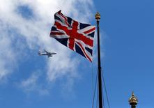 A British Airways passenger jet flies over the Union Flag above the Houses of Parliament in Westminster, in central London, Britain June 24, 2016.     REUTERS/Phil Noble