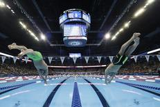 Jun 26, 2016; Omaha, NE, USA; Ryan Lochte (left) and Chase Kalisz (right) dive into the pool at the start of the men's 400m individual medley finals in the U.S. Olympic swimming team trials at CenturyLink Center. Mandatory Credit: Rob Schumacher-USA TODAY Sports