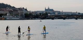 File photo of People paddling on their boards on the Vltava river in central Prague August 21, 2013. REUTERS/David W Cerny