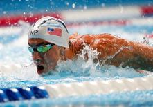 Jul 1, 2016; Omaha, NE, USA; Michael Phelps swims during the men's 100 meter butterfly semifinal in the U.S. Olympic swimming team trials at CenturyLink Center. Mandatory Credit: Erich Schlegel-USA TODAY Sports