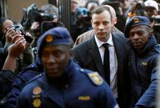 Olympic and Paralympic track star Oscar Pistorius is escorted by police officers as he arrives for his sententencing for the 2013 murder of his girlfriend Reeva Steenkamp, at North Gauteng High Court in Pretoria, South Africa July 6, 2016. REUTERS/Siphiwe Sibeko