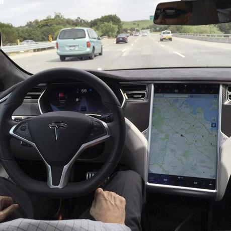 The interior of a Tesla Model S is shown in autopilot mode in San Francisco, California, U.S., April 7, 2016.   REUTERS/Alexandria Sage/File Photo