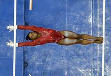 Jul 10, 2016; San Jose, CA, USA; Simone Biles from Spring, TX, during the uneven bars in the women's gymnastics U.S. Olympic team trials at SAP Center. Mandatory Credit: Robert Hanashiro-USA TODAY Sports