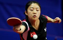 Melek Hu of Turkey returns a ball to Fang Zhu of Spain in their quarterfinal match of the women's singles at the 2010 European Table Tennis Championships in Ostrava, September 18, 2010.  REUTERS/Petr Josek