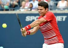 Jul 28, 2016; Toronto, Ontario, Canada; Milos Raonic of Canada plays a shot against Jared Donaldson of USA on day four of the Rogers Cup tennis tournament at Aviva Centre. Mandatory Credit: Dan Hamilton-USA TODAY Sports