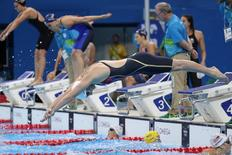 Aug 6, 2016; Rio de Janeiro, Brazil; Katie Ledecky (USA) swims in the women's 4x100m freestyle relay heats during the Rio 2016 Summer Olympic Games at Olympic Aquatics Stadium. Mandatory Credit: Erich Schlegel-USA TODAY Sports