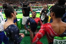 Aug 7, 2016; Rio de Janeiro, Brazil; Simone Biles (USA) reacts with teammates during women's gymnastic qualifications in the Rio 2016 Summer Olympic Games at Rio Olympic Arena. Mandatory Credit: Robert Deutsch-USA TODAY Sports