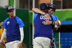 Aug 6, 2016; Rio de Janeiro, Brazil; Brady Ellison (USA), back to camera, reacts with Jake Kaminski as Zach Garrett looks on at left in the men's team gold medal match at Sambodromo during the Rio 2016 Summer Olympic Games. Mandatory Credit: Christopher Hanewinckel-USA TODAY Sports