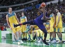 Team USA's Kevin Durant goes out of bounds as Joe Ingles of Australia watches. REUTERS/Jim Young