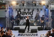 Actor and director Ricky Gervais (C) performs as his character David Brent with backing band Foregone Conclusion at the world premiere of his film David Brent Life on the Road in London, Britain August 10, 2016. REUTERS/Neil Hall