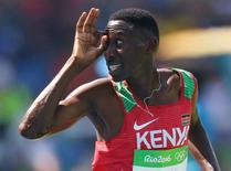 Conseslus Kipruto of Kenya gestures as he crosses the finish line to win the gold in the men's 3000m steeplechase. REUTERS/Ivan Alvarado