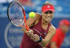 Aug 17, 2016; Mason, OH, USA; Angelique Kerber (GER) returns a shot against Kristina Mladenovic (FRA) on day five during the Western and Southern tennis tournament at Linder Family Tennis Center. Mandatory Credit: Aaron Doster-USA TODAY Sports