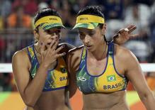 2016 Rio Olympics - Beach Volleyball - Women's Gold Medal Match - Germany v Brazil - Beach Volleyball Arena - Rio de Janeiro, Brazil - 18/08/2016. Agatha Bednarczuk (BRA) of Brazil and Barbara Seixas Figueiredo (BRA) of Brazil react. REUTERS/Tony Gentile FOR EDITORIAL USE ONLY. NOT FOR SALE FOR MARKETING OR ADVERTISING CAMPAIGNS.