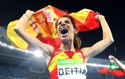 2016 Rio Olympics - Athletics - Final - Women's High Jump Final - Olympic Stadium - Rio de Janeiro, Brazil - 20/08/2016. Ruth Beitia (ESP) of Spain celebrates winning gold.  REUTERS/Dominic Ebenbichler