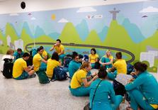 Members of Australia's cycling and water polo teams wait for their flight home at the international airport in Rio de Janeiro, Brazil August 22, 2016.  REUTERS/Chris Helgren