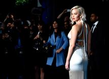 1: Jennifer Lawrence is again the world's highest-paid actress, according to the latest ranking from Forbes. The Hunger Games star earned $46 million over the past year.  REUTERS/Hannah McKay