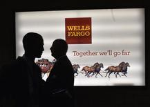 Men pass a sign at Wells Fargo Center at the Democratic National Convention in Philadelphia, Pennsylvania, U.S. July 25, 2016 REUTERS/Charles Mostoller