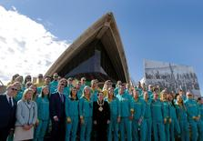 Sydney's Lord Mayor Clover Moore (C) poses for a picture with Australia's Olympic athletes returning from Rio during an official welcome ceremony at the Sydney Opera House in Australia, August 29, 2016.   REUTERS/Jason Reed