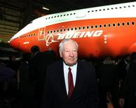 """Joe Sutter, Boeing's chief engineer on the original jumbo, and known as the """"father of the 747."""" walks in front of a newly unveiled 747-8 jumbo passenger jet at the company's Everett, Washington commercial airplane manufacturing facility, February 13, 2011.  REUTERS/Anthony Bolante"""