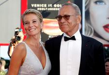 """Director Andrei Konchalovsky (R) poses with actress Julia Vysotskaya as they attend the red carpet for the movie """"Paradise"""" at the 73rd Venice Film Festival in Venice, Italy September 8, 2016. REUTERS/Alessandro Bianchi"""