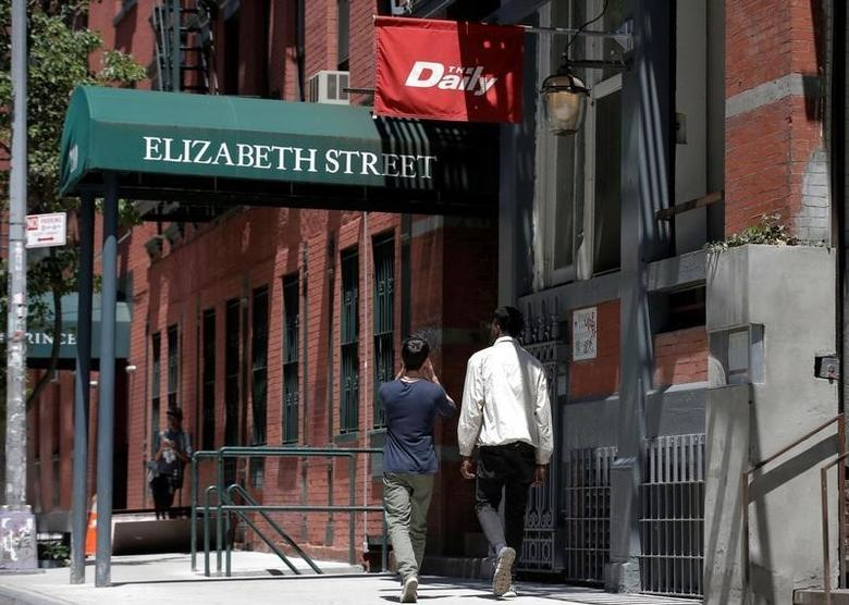 People walk past a building that lists offices for Gawker Media in New York City, U.S., June 10, 2016.  REUTERS/Brendan McDermid