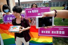Qiu Bai, a Chinese student who lodged a suit against the Ministry of Education over school textbooks describing homosexuality as a mental disorder, shows the present she prepared for officials near the courthouse before the hearing in Beijing, China September 12, 2016. REUTERS/Damir Sagolj