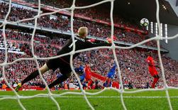 Liverpool's Adam Lallana scores their third goal. Liverpool v Leicester City - Premier League - Anfield - 10/9/16. Reuters / Darren Staples Livepic
