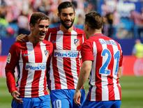 Spanish Liga Santander - Atletico Madrid v Sporting - Vicente Calderon stadium, Madrid, Spain 17/09/16 Atletico Madrid's Antoine Griezmann celebrates a goal with teammates Yannick Ferreira-Carrasco and Kevin Gameiro. REUTERS/Sergio Perez