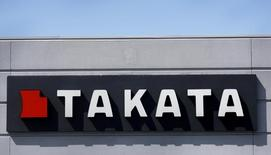 A sign with the TAKATA logo is seen outside the Takata Corporation building in Auburn Hills, Michigan May 20, 2015. REUTERS/Rebecca Cook/File Photo