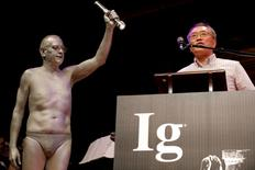 "Atsugi Higashiyama of Japan accepts the 2016 Ig Nobel Prize in Perception for ""investigating whether things look different when you bend over and view them between your legs"" during the 26th First Annual Ig Nobel Prize ceremony at Harvard University in Cambridge, Massachusetts, U.S. September 22, 2016.  REUTERS/Brian Snyder"