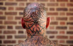 A tattoo enthusiast poses at the International London Tattoo Convention in London. REUTERS/Neil Hall