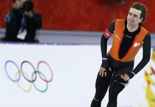 Mark Tuitert of the Netherlands reacts after the men's 1,500 metres speed skating race in the Adler Arena at the Sochi 2014 Winter Olympic Games February 15, 2014. REUTERS/Issei Kato