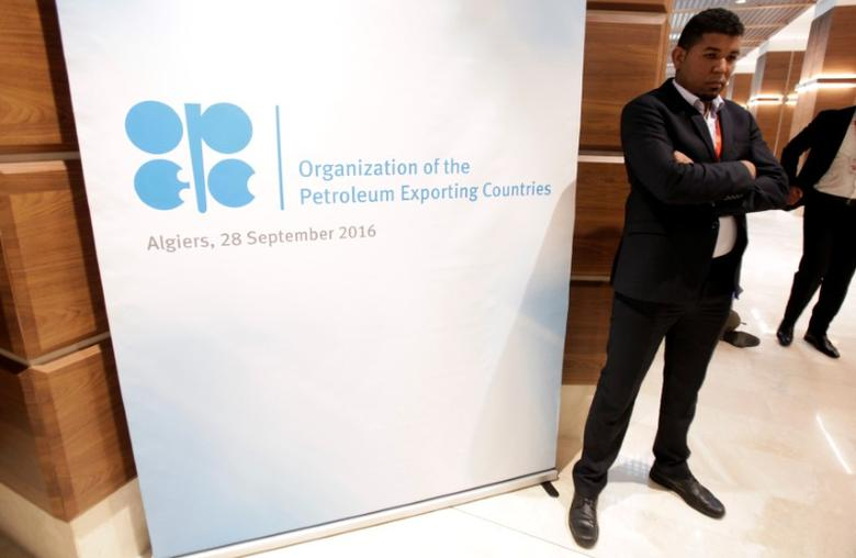 An employee is seen standing ahead of an informal meeting between members of the Organization of the Petroleum Exporting Countries (OPEC) in Algiers, Algeria September 28, 2016. REUTERS/Ramzi Boudina