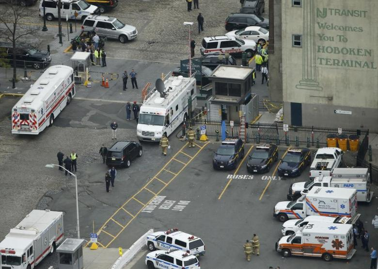 Emergency vehicles are seen in an aerial view outside the New Jersey Transit station following a train derailment and crash in Hoboken, New Jersey, U.S. September 29, 2016.    REUTERS/Carlo Allegri