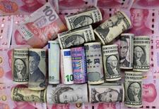 Euro, Hong Kong dollar, U.S. dollar, Japanese yen, British pound and Chinese 100-yuan banknotes are seen in a picture illustration, in Beijing, China, January 21, 2016. REUTERS/Jason Lee
