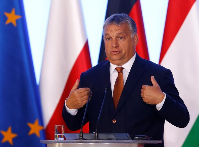 Hungary's Prime Minister Viktor Orban speaks during a news conference in Warsaw, Poland, August 26, 2016. REUTERS/Kacper Pempel