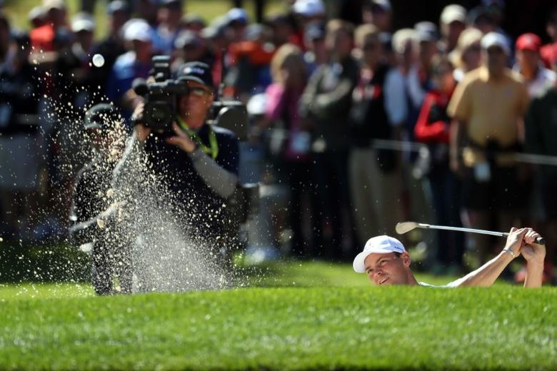 Sep 30, 2016; Chaska, MN, USA;  Martin Kaymer of Germany plays a shot from a bunker on the second hole in the afternoon four-ball matches during the 41st Ryder Cup at Hazeltine National Golf Club. Mandatory Credit: Rob Schumacher-USA TODAY Sports