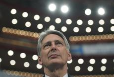Britain's Chancellor of Exchequer Philip Hammond watches Prime Minister Theresa May speak at the annual Conservative Party Conference in Birmingham, Britain, October 2, 2016. REUTERS/Toby Melville