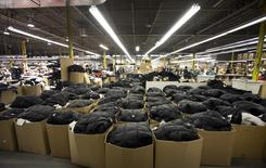 Outerwear ready for shipping is seen packed in boxes on the manufacturing floor of Canada Goose's facility in Toronto January 17, 2012. . REUTERS/Fred Thornhill