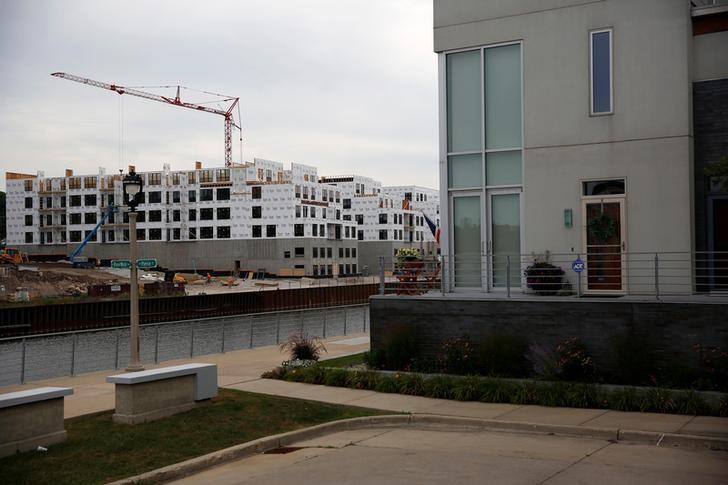 New developments are seen under construction along the RiverWalk, adjoining downtown Milwaukee, Wisconsin, U.S. August 15, 2016. REUTERS/Aaron P. Bernstein